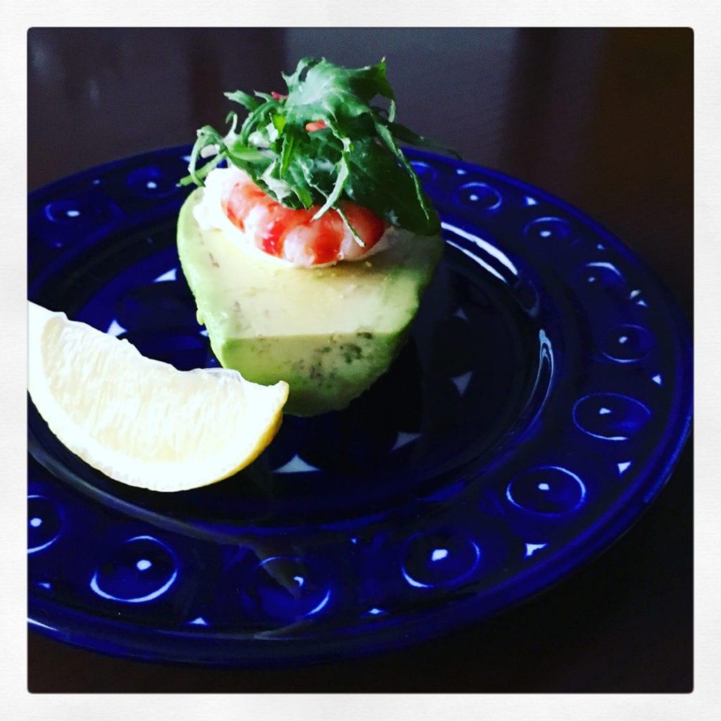 Avocado salad made with boiled shrimp, chopped celery and onion, sour cream